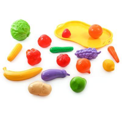 Набор фруктов и овощей на тачке в сетке