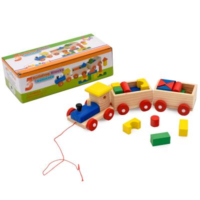 Деревянная игрушка каталка паравозик с геометричес