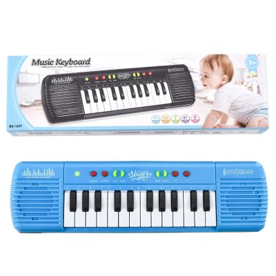 Музыкальный синтезатор, в коробке, маленький